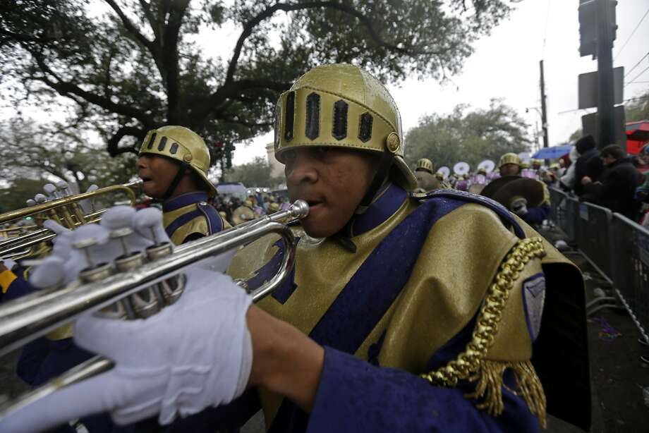 Members of the St. Augustine High Marching 100 band march in the Krewe of Zulu parade during Mardi Gras day in New Orleans, Tuesday, March 4, 2014. The Zulu parade began on schedule, led by a New Orleans police vanguard on horseback that included Mayor Mitch Landrieu. Photo: Gerald Herbert, Associated Press