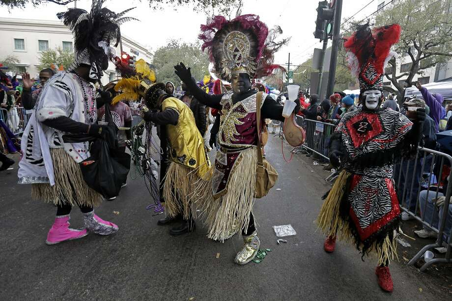 Members of the Krewe of Zulu march during Mardi Gras day in New Orleans, Tuesday, March 4, 2014. The Zulu parade began on schedule, led by a New Orleans police vanguard on horseback that included Mayor Mitch Landrieu. Photo: Gerald Herbert, Associated Press