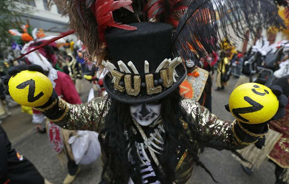 Members of the Krewe of Zulu march during Mardi Gras day in New Orleans, Tuesday, March 4, 2014. Despite rain and cold in Tuesday's forecast, revelers are gathering along parade routes as the Carnival season in New Orleans heads to a crest with the unabashed celebration of Mardi Gras. The Zulu parade began on schedule, led by a New Orleans police vanguard on horseback that included Mayor Mitch Landrieu. Photo: Gerald Herbert, Associated Press