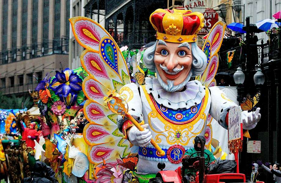 Members of Rex parade down St. Charles Avenue despite the rain Mardi Gras Day on March 4, 2014 in New Orleans, Louisiana. Fat Tuesday, the traditional celebration on the day before Ash Wednesday and the begining of Lent, is marked in New Orleans with parades and marches through many neighborhoods in the city. Photo: Sean Gardner, Getty Images