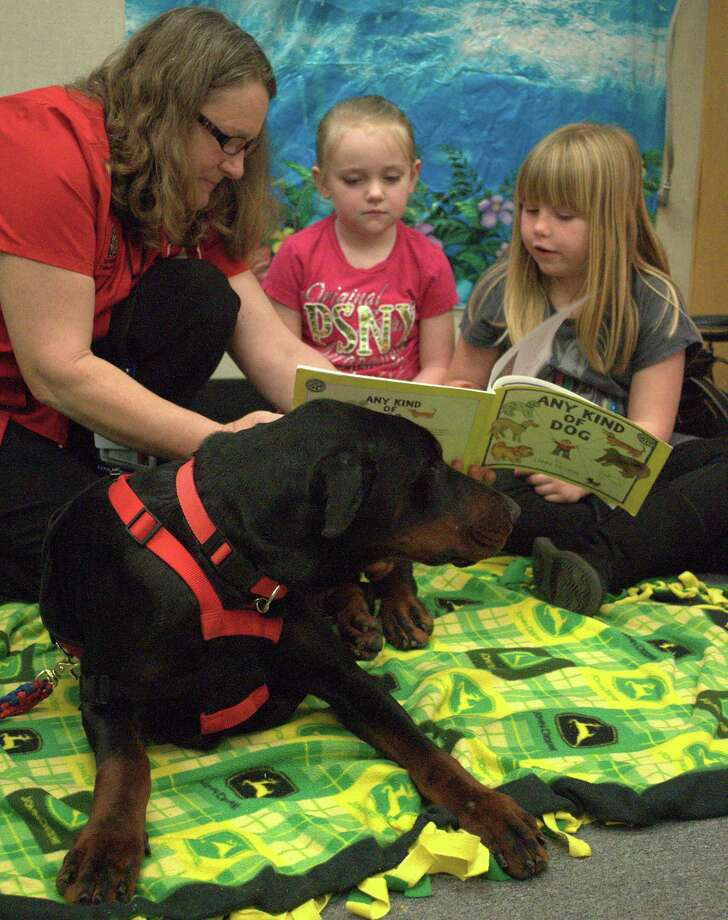 Paws 4 Love of Southeast Texas brought a few of their therapy dogs to Kountze Elementary School for the children to meet. The nonprofit's pet and handler teams visit nursing homes, hospitals, school, churches and more to provide love to those ill, confined or as a way to promote reading in youth. Each elementary student in attendance read to a dog and was sent home with a new book. Photo: Cassie Smith/@smithcassie.