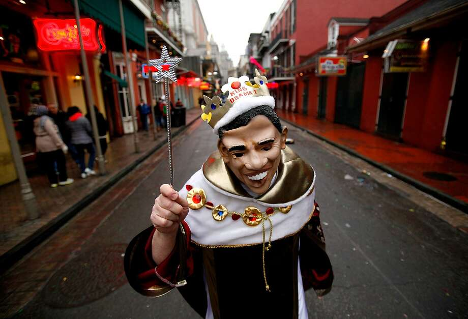 "ObamaScare: As New Orleans celebrates Mardi Gras, ""King Obama"" roams the streets of the French Quarter, waving a wand. Photo: Sean Gardner, Getty Images"