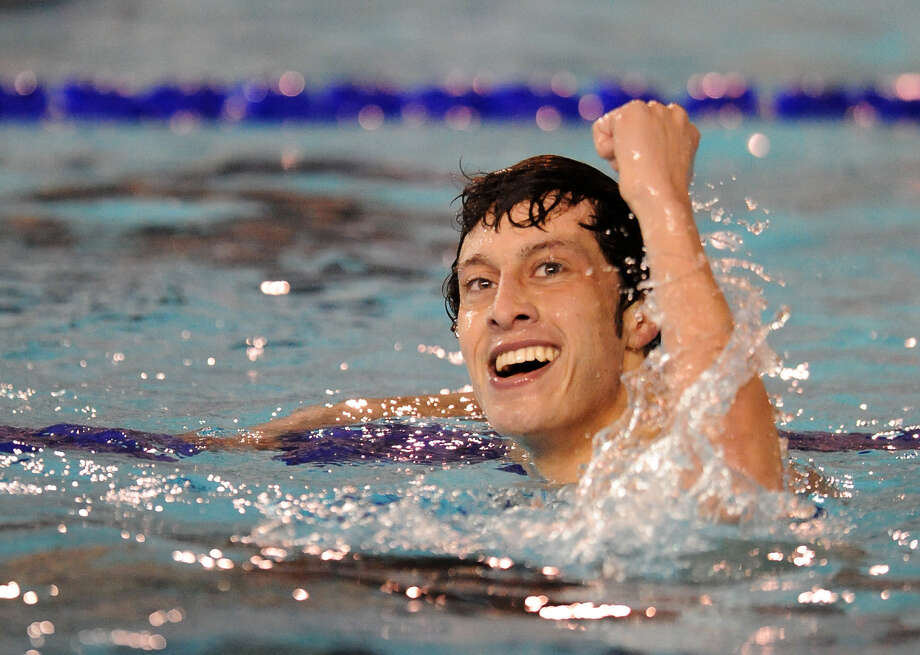 Then-Reagan senior Donnie Walker celebrates at the 2010 Region VII-5A Championships. He now swims for both Texas A&M and the Mexican national team. Photo: File Photo / San Antonio Express-News / San Antonio Express-News