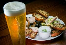 """The """"Butcher's Coffer"""" with Hog's Head Terrine, Potted Pork, and whipped Lardo and a Reality Czeck pilsner at Hogsapothecary in Oakland, Calif., is seen on Wednesday, February 26th, 2014."""