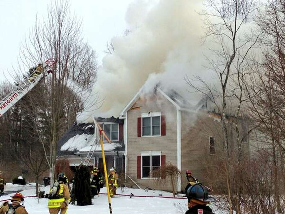 Firefighters attack a blaze at Maple Lane in Niskayuna on Tuesday afternoon. (Skip Dickstein / Times Union)