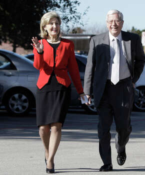 ** CORRECTS SPELLING OF BAILEY ** Texas gubernatorial candidate, U.S. Sen. Kay Bailey Hutchison, R-texas, left, waves to supporters as she walks with her husband attorney Ray Hutchison on their way for early voting in Dallas,  Tuesday, Feb. 16, 2010. Photo: LM Otero, AP / AP