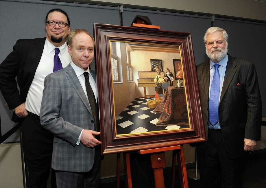Illusionists Penn Jillette, from left, and Teller pooled their money to fund Jenison's documentary. Photo: Angela Weiss, Stringer / 2014 Getty Images