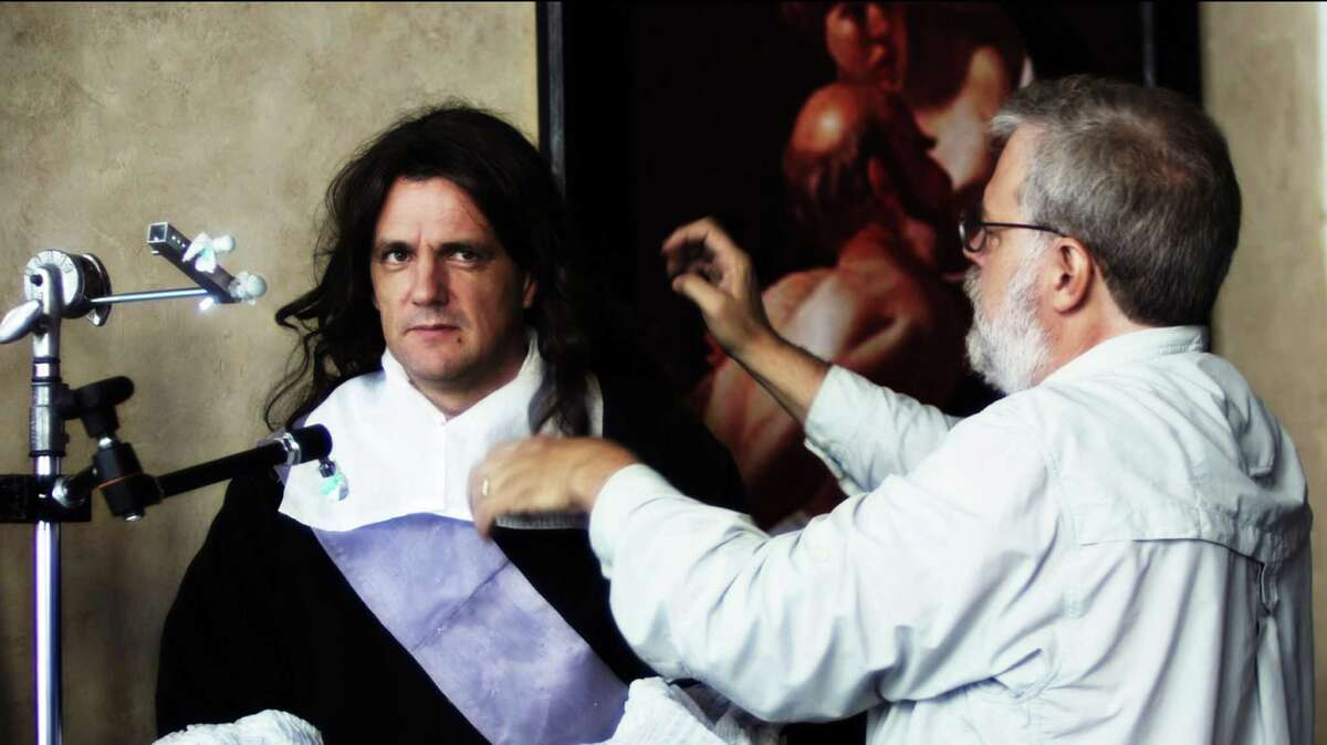 """This film image released by Sony Pictures Classics shows Tim Jenison, right, adjusting the wig of model Graham Toms in """"Tim's Vermeer."""" (AP Photo/Sony Pictures Classics, Shane F. Kelly)"""