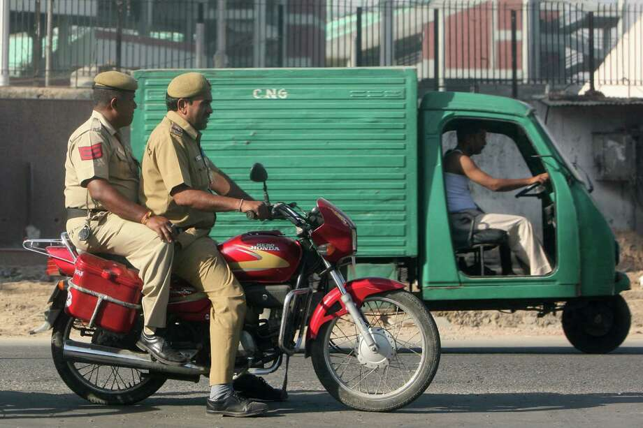 Cops in New Delhi ride two-up on a Honda Hero, a collaboration between India's Hero and Japan's Honda motorcycle manufacturers. Photo: Mail Today, India Today Group/Getty Images / Mail Today