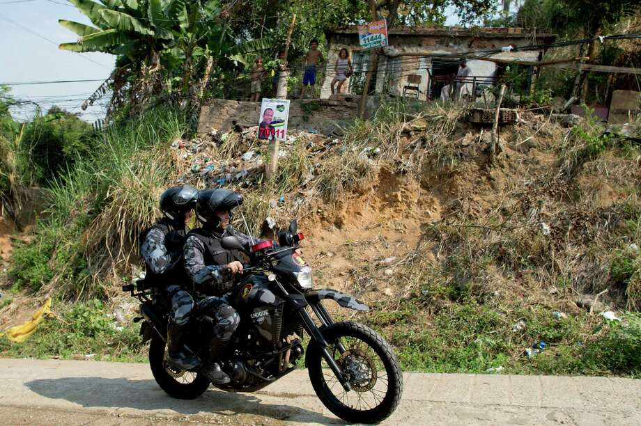 These paramilitary police in Brazil ride two-up on a Yamaha WR450F dirt bike. Photo: CHRISTOPHE SIMON, AFP/Getty Images / 2012 AFP