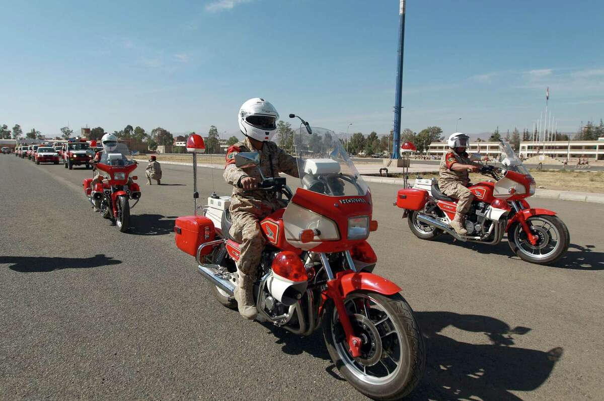 Motorcycle Military Police in Yemen ride classic fully-faired Honda CBX750 motorcycles.