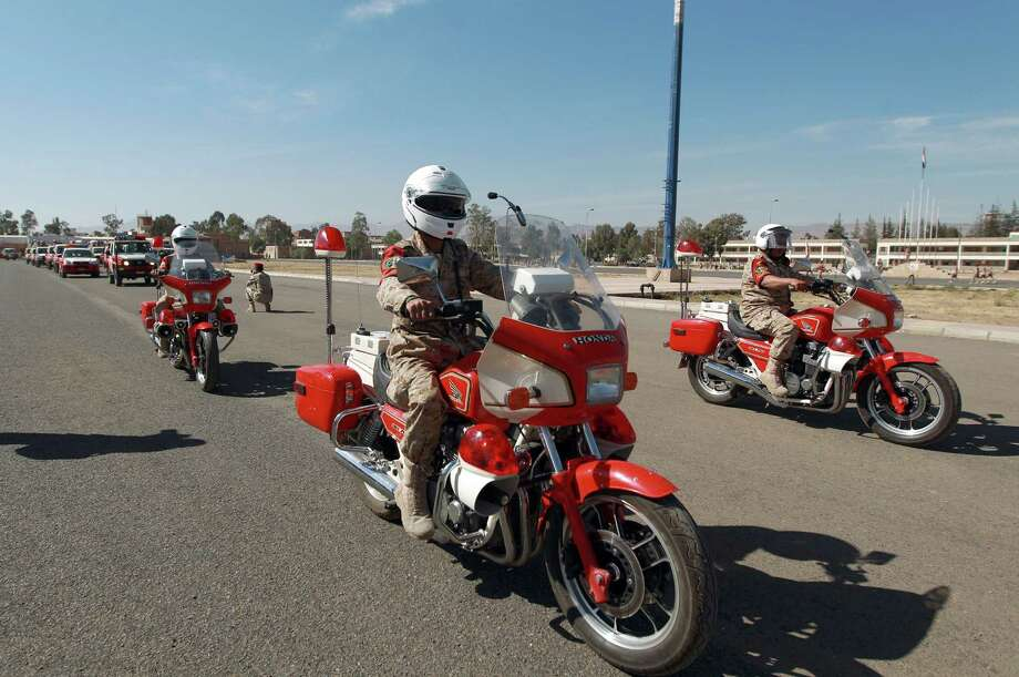 Motorcycle Military Police in Yemen ride classic fully-faired Honda CBX750 motorcycles. Photo: MOHAMMED HUWAIS, AFP/Getty Images / 2014 AFP