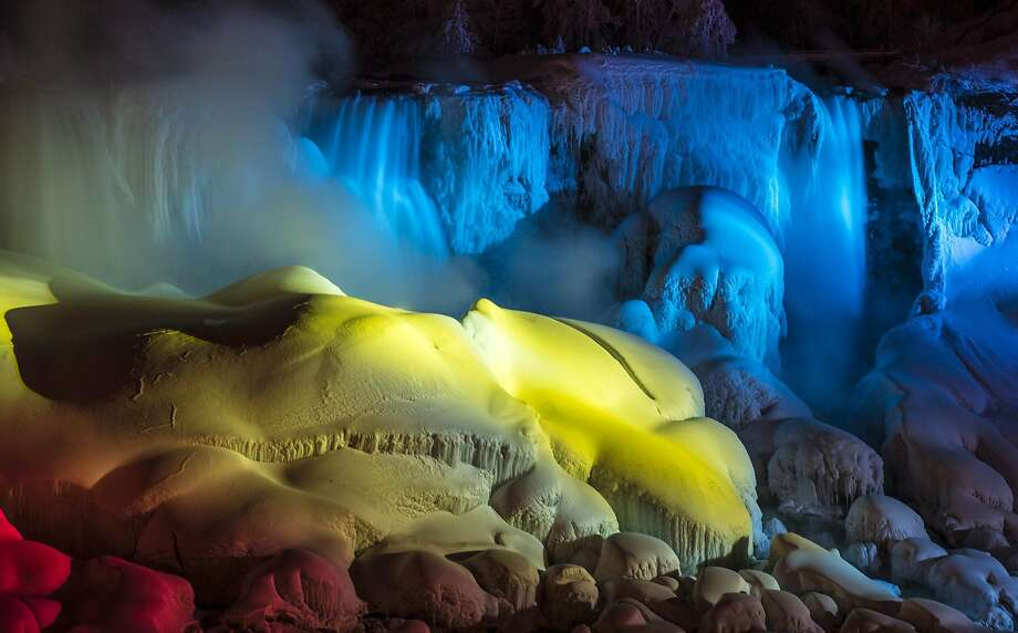 Niagara Falls has again been transformed into a winter wonderland, thanks to the latest arctic air mass smothering north-central United States and Canada. Neon lights paint the ice with bold colors. Photo: Mark Blinch, Reuters