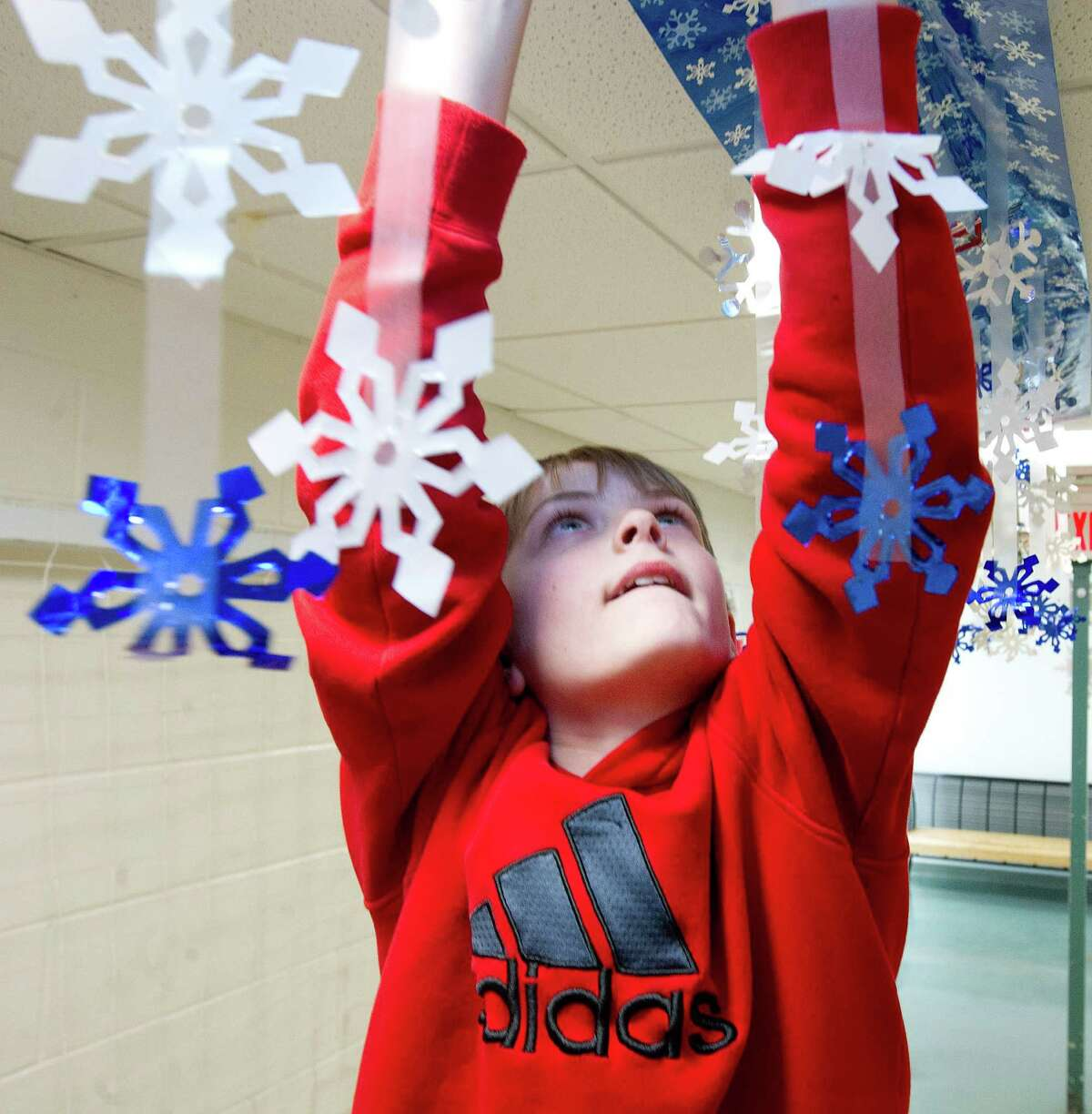 Alex LaValle, 11, helps decorate at Scofield Magnet School for the dance on Friday, February 28, 2014.