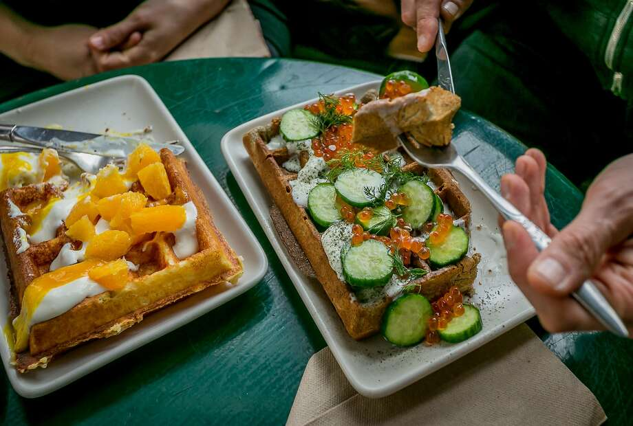 Waffles come sweet (fruit and Greek yogurt, above left) or savory (creme fraiche, cucumbers, dill and salmon roe), and some even have meat (pastrami and potato, below) at Linea Caffe. Photo: John Storey, Special To The Chronicle