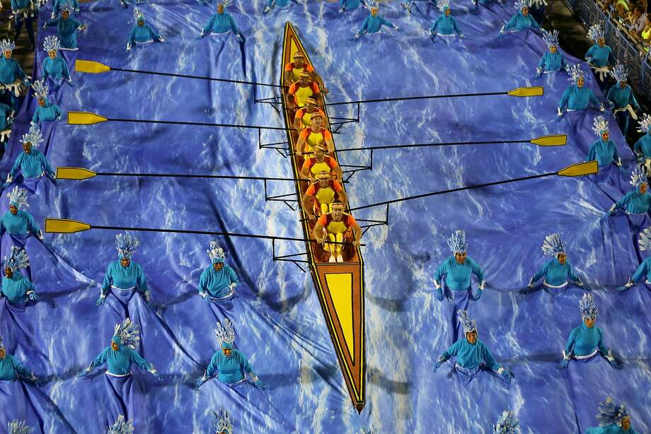 Whatever floats your boat:Oarsmen of the Unidos da Tijuca samba school row over a river of revelers during the Sambadrome carnival parade in Rio de Janeiro. Photo: Tasso Marcelo Leal, AFP/Getty Images