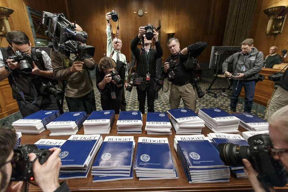 Copies of President Obama's proposed fiscal 2015 federal budget are set out for distribution by the Senate Budget Committee on Capitol Hill. Photo: J. Scott Applewhite, Associated Press