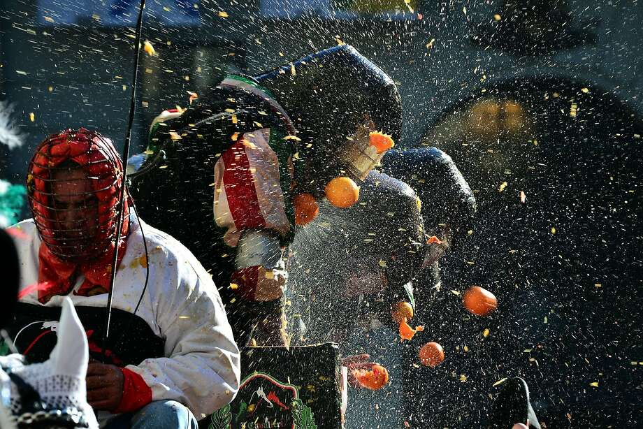 Tutti frutti:In Turin, Italians celebrate Fat Tuesday by pelting each other with oranges. The citrus battle recalls a popular rebellion against the tyrannical lords who ruled the city in the Middle Ages. Photo: Giuseppe Cacace, AFP/Getty Images