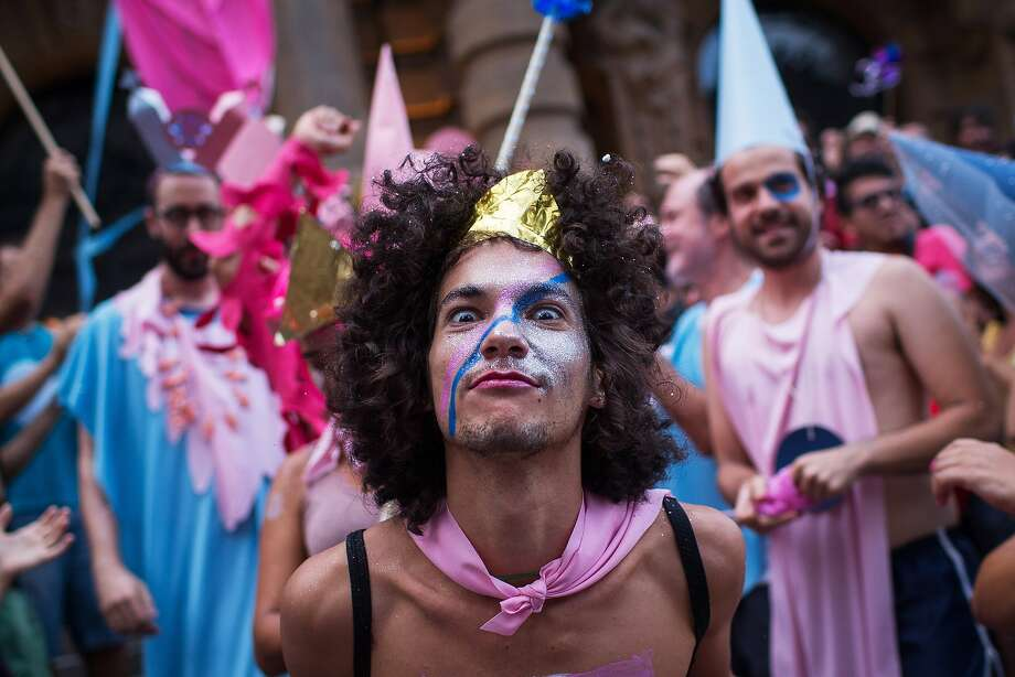 Anything goes, wardrobe-wise: Revelers wear clothing of the opposite sex during the Lambuza cross-dressing carnival in downtown Sao Paulo. The purpose of the festival is to satirize sexism and prejudice against the gay community. Photo: Victor Moriyama, Getty Images