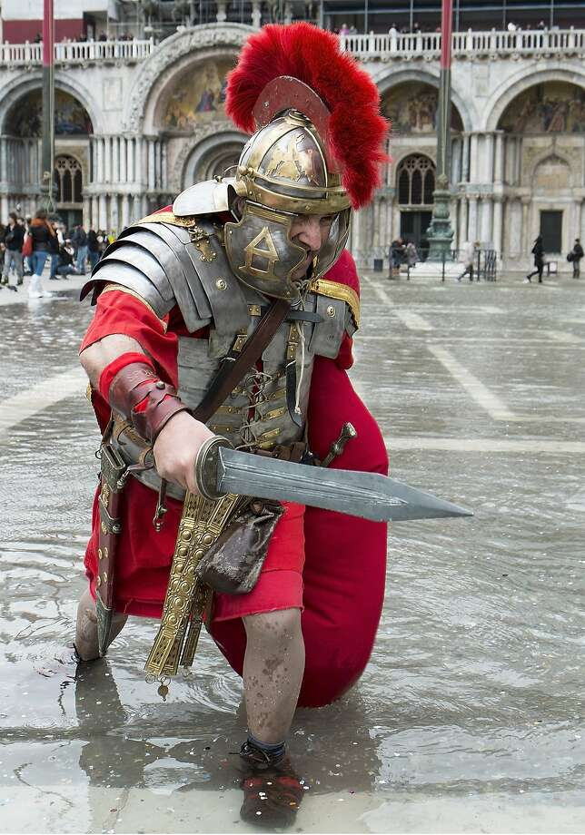 Hail, Centurion! Better cover up those legs - you could catch Legionnaire's Disease. Or trench foot, anyway. (St. Mark's Square, Venice.) Photo: Marco Secchi, Getty Images