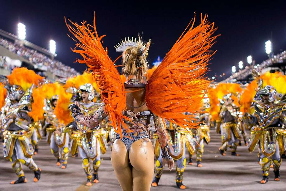 Nothing to wear for Fat Tuesday? Just wing it: Colorfully costumed members of the Unidos da Tijuca Samba School parade at the Sapucai Sambadrome in Rio de Janeiro. Photo: Buda Mendes, Getty Images