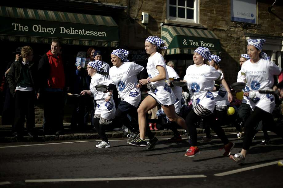 Champions of breakfast: It wouldn't be Shrove Tuesday without the traditional running of the trans-Atlantic pancake race in Olney, Buckinghamshire. Every year on the date, women clad in aprons and head scarves from Olney and Liberal, Kan., race while flipping pancakes in a pan. According to legend, the Olney race started in 1445 when a harried housewife arrived at church on Shrove Tuesday still clutching her frying pan with a pancake in it. The Kansas town challenged Olney to an international competition in 1950 after seeing photos of the race in a magazine. Photo: Matt Dunham, Associated Press