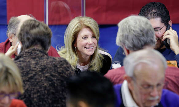 Texas Sen. Wendy Davis, D-Fort Worth, visits with volunteers manning a call center at her campaign headquarters, Tuesday, March 4, 2014, in Fort Worth, Texas. Texas is holding the nation's first primary election Tuesday with a political free-for-all in Republican races that could push the state further right, though Democrats are calling it the next big electoral battleground with Davis running for governor. (AP Photo/LM Otero) Photo: LM Otero, Associated Press / AP