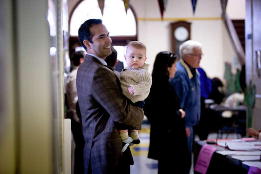 George P. Bush, holding his with son Prescott, turned out to vote in the primary election  Tuesday, March 4, 2014, at North High Mount Elementary School in Fort Worth, Texas. The 37-year-old nephew of former President George W. Bush, and son of former Florida Gov. Jeb Bush, is running for land commissioner in the state. (AP Photo/The Fort Worth Star-Telegram, Joyce Marshall) Photo: Joyce Marshall, Associated Press / The Fort Worth Star-Telegram