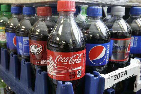 FILE - This Feb. 13, 2014 file photo shows sugary sodas in Sacramento, Calif.  Since 2005, carbonated soft drinks have been in decline in the U.S. overall, said John Sicher, editor and publisher of the news and data service Beverage Digest. The overall volume has decreased from 10.2 billion cases to 9.2 billion cases. In terms of individual consumption, there's been a corresponding decline. Much of that consumption decline is due to a migration to other categories, primarily bottled water. Between 1999 and 2010, daily calories from soda consumed by 2- to 5-year-olds decreased on average from 106 to 69, according to the National Health and Nutrition Examination Survey, which is conducted by the National Center for Health Statistics. (AP Photo/Rich Pedroncelli, File)