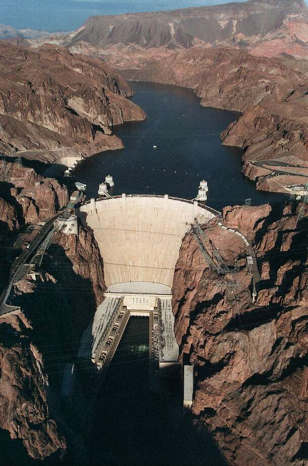 If you want to experience the Hoover Dam, do it in a different way; Spend the day on Lake Mead, shown here in the background of the dam in this Dec. 31, 1999 file photo taken near Las Vegas.  Photo: Jim Laurie, Associated Press