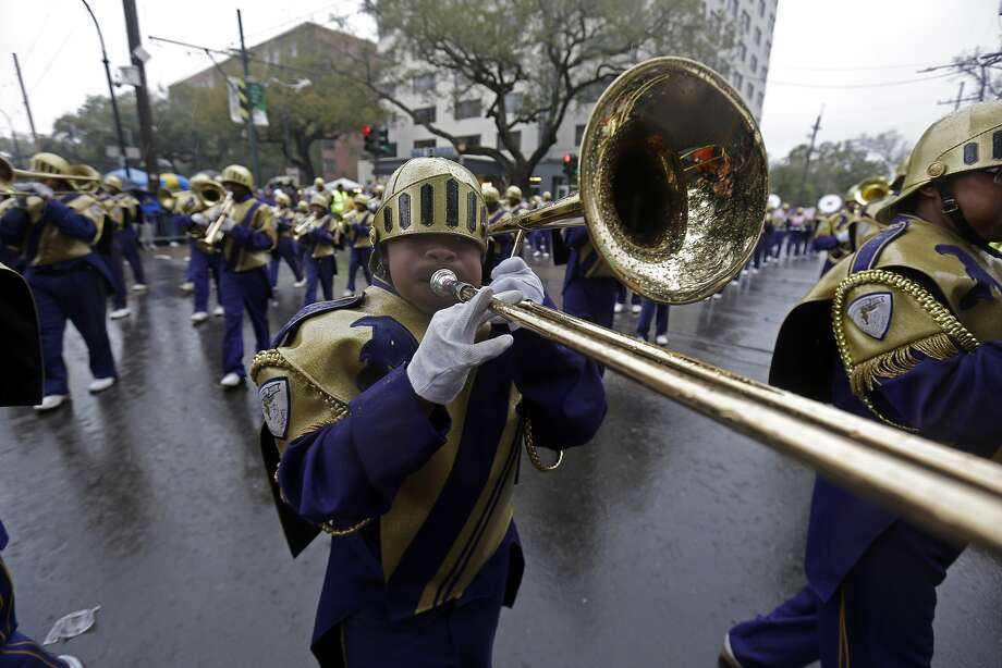 Members of the St. Augustine High Marching 100 band march in the Krewe of Zulu parade during Mardi Gras day in New Orleans, Tuesday, March 4, 2014. (AP Photo/Gerald Herbert) Photo: Gerald Herbert, Associated Press