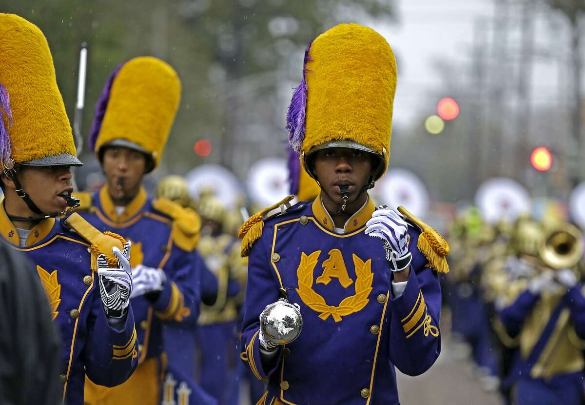 Drum Majors from the St. Augustine High Marching 100 band march in the Krewe of Zulu parade during Mardi Gras day in New Orleans, Tuesday, March 4, 2014. (AP Photo/Gerald Herbert)