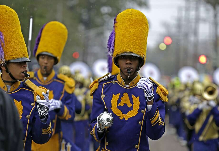 Drum Majors from the St. Augustine High Marching 100 band march in the Krewe of Zulu parade during Mardi Gras day in New Orleans, Tuesday, March 4, 2014. (AP Photo/Gerald Herbert) Photo: Gerald Herbert, Associated Press