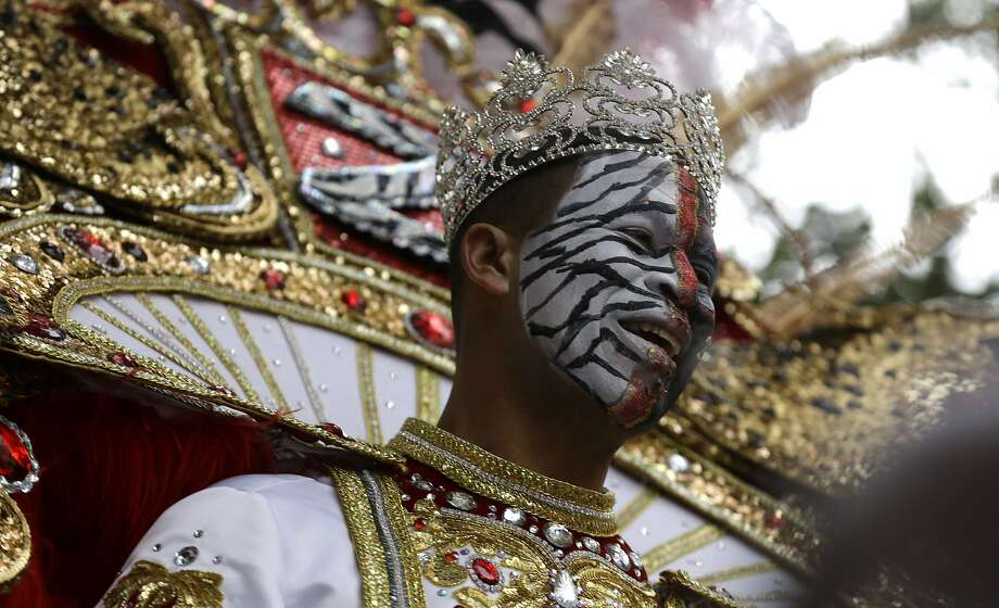 Garren Thomas Mims Sr., King of the Krewe of Zulu, rides his float during Mardi Gras day in New Orleans, Tuesday, March 4, 2014. (AP Photo/Gerald Herbert) Photo: Gerald Herbert, Associated Press