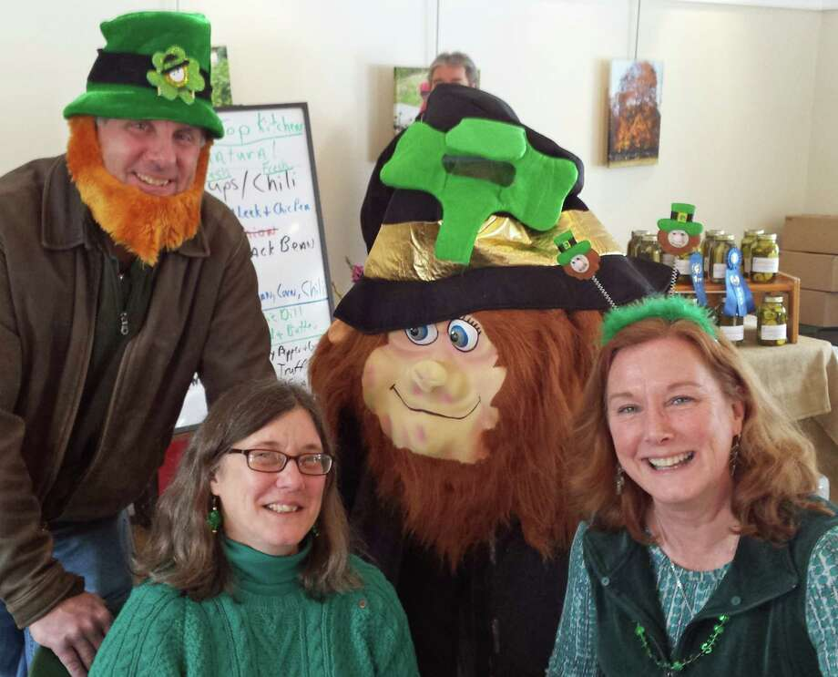 The Kiwanis Club's St. Patrick's Day Planning Committee members include, from left, Jeff Holland, Beth Jones, Kathleen Holland and Liam the Lucky Leprechaun. Photo: Contributed Photo, Contributed / New Canaan News Contributed