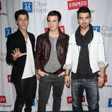 (L-R) Nick Jonas, Kevin Jonas and Joe Jonas of The Jonas Brothers attend the 2011 Concert For Hope at Gibson Amphitheatre on March 20, 2011 in Universal City, California. (elevatorpitch)