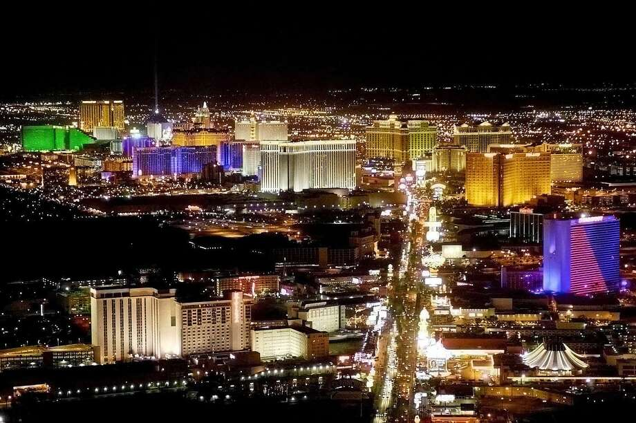 Go Las Vegas gazing. Watch the city at dark from any of the surrounding hills. Pictured: The Vegas strip in a April 19, 2001 file photo. Photo: Matt York, AP