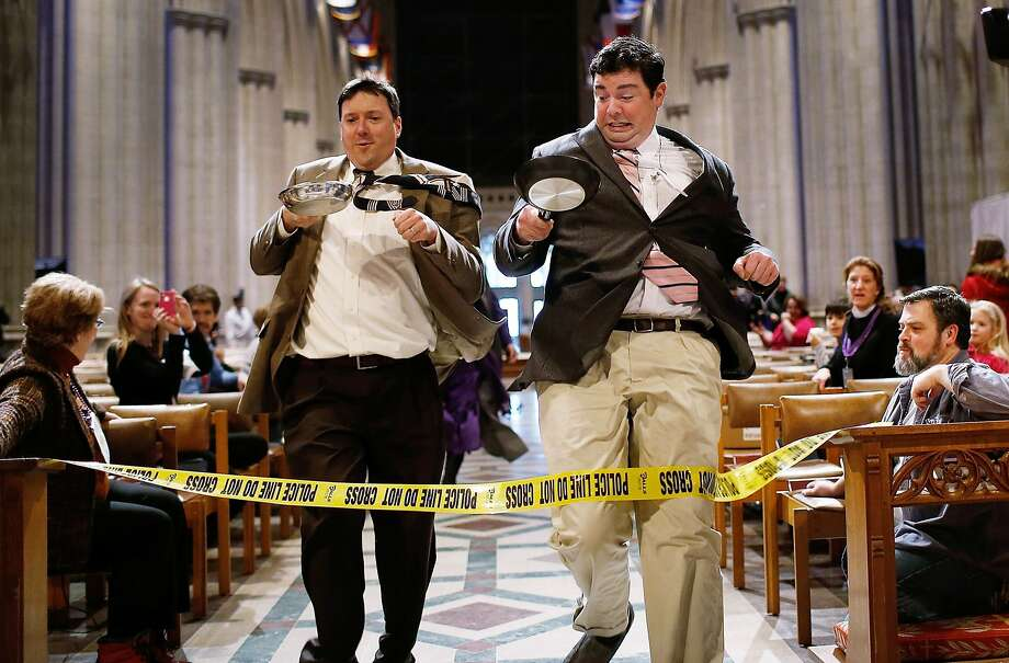 Contestants compete in the Washington National Cathedral's Shrove Tuesday Pancake Race, held in the cathedral's nave due to inclement weather. Photo: Win McNamee, Getty Images