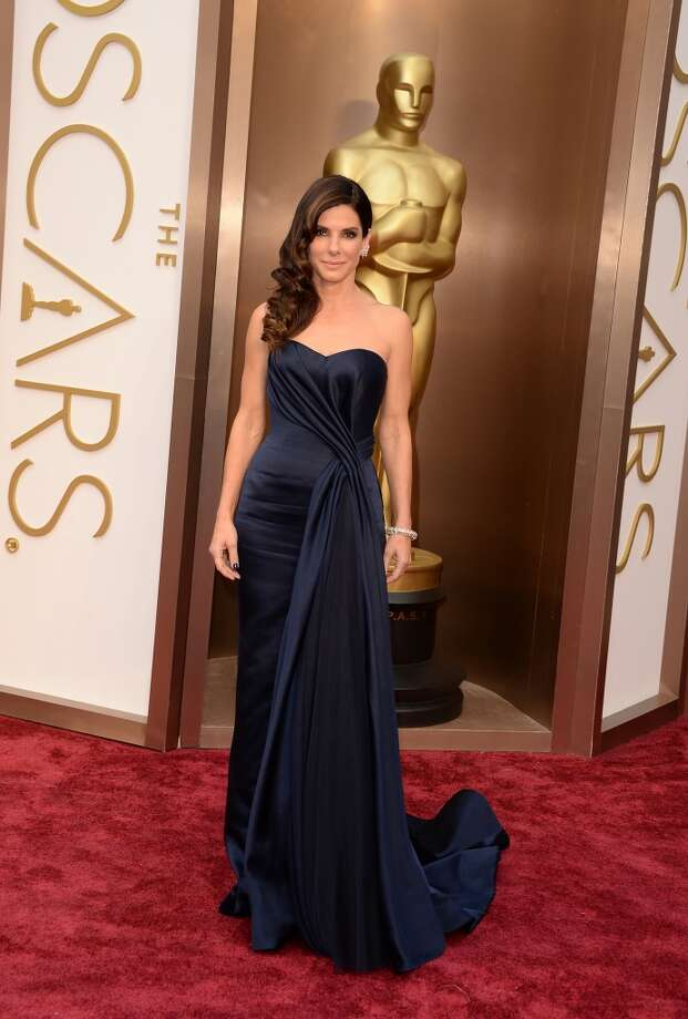 The people have Tweeted and Sandra Bullock,  in an Alexander McQueen navy blue strapless draped gown, wins best dress at the Oscars  with 23  percent of the #BestDressed votes via Twitter from Sunday night to Monday afternoon.   (Photo by Jason Merritt/Getty Images) Photo: Jason Merritt, Getty Images