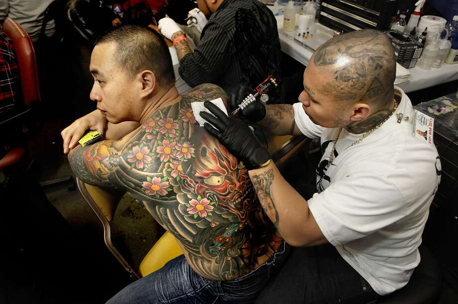 Get some ink. Las Vegas has an unusually large concentration of tattoo shops -- 16 shops per 100,000 people, according to Total Beauty, which ranked Vegas as the second U.S. city with the most tattoos. Pictured: Richard Tio, (left) gets a touch up on his creation by artist Nes Andrion, (right) of  Stain Tattoo, located in Las Vegas, during the Body Art Expo at the Cow Palace on Saturday March 24, 2012, in San Francisco, Ca. Photo: Michael Macor, The Chronicle