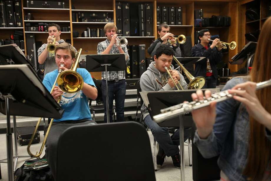 "Concord High jazz band members preparing ""Take Five"" include trumpeters Johnny O'Shea (left), Jacob Rummel, James Olesen and Luigi Asuncion; trombonists Dylan Parisi (left) and Jaryss Salguero; and flutist Emily Lohman. Photo: Leah Millis, The Chronicle"