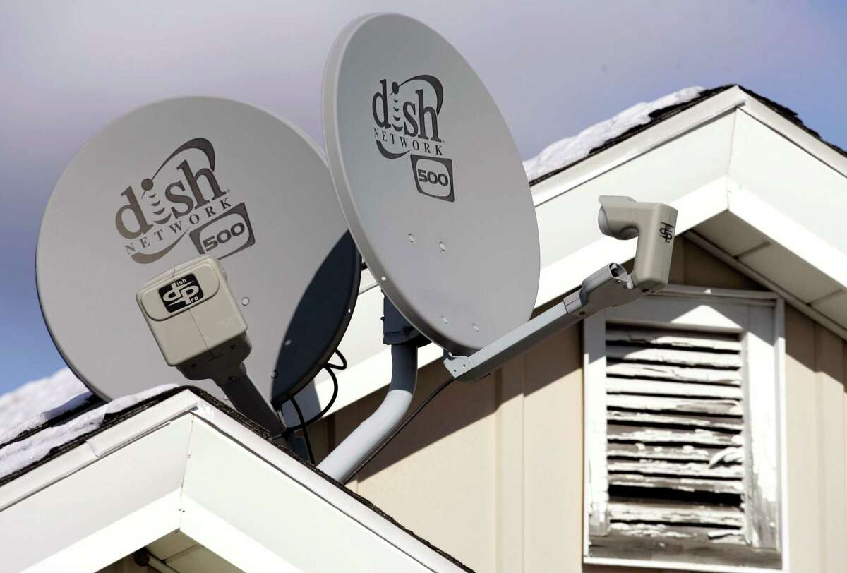 FILE - In this Nov. 10, 2008 file photo, Dish Network Corp. satellite dishes are attached to a home in Buffalo, N.Y. Dish Network and Disney have reached a landmark deal Tuesday, March 4, 2014, that envisions the day when Dish will offer a Netflix-like TV service to people who'd rather stream TV over the Internet than put a satellite receiver on their roof. (AP Photo/David Duprey, file) ORG XMIT: NYBZ126