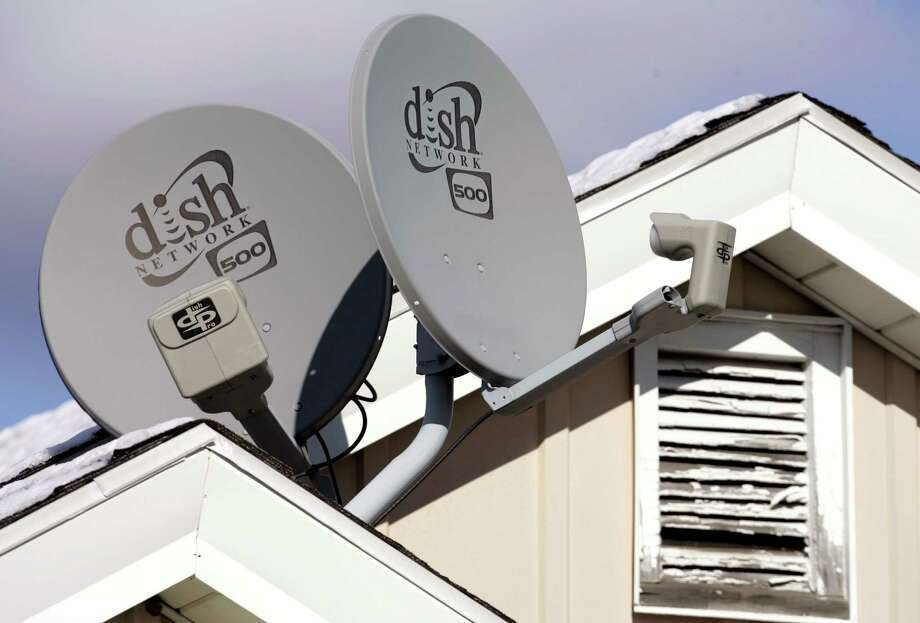 FILE - In this Nov. 10, 2008 file photo, Dish Network Corp. satellite dishes are attached to a home in Buffalo, N.Y.  Dish Network and Disney have reached a landmark deal Tuesday, March 4, 2014,  that envisions the day when Dish will offer a Netflix-like TV service to people who'd rather stream TV over the Internet than put a satellite receiver on their roof.  (AP Photo/David Duprey, file) ORG XMIT: NYBZ126 Photo: David Duprey / AP