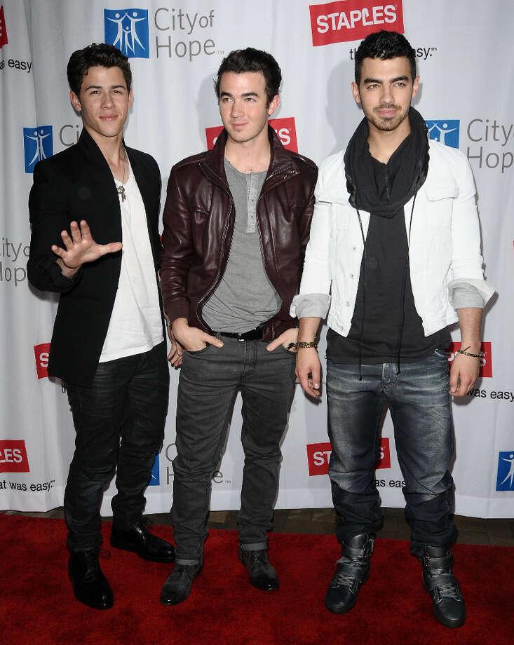 (L-R) Nick Jonas, Kevin Jonas and Joe Jonas of The Jonas Brothers attend the 2011 Concert For Hope at Gibson Amphitheatre on March 20, 2011 in Universal City, California. (elevatorpitch) Photo: Jason LaVeris, FilmMagic / 2011 Jason LaVeris
