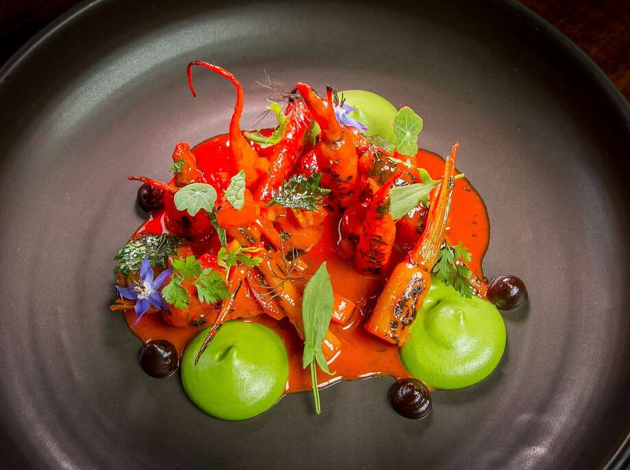 Carrots look as if they're in a garden landscape in this dish, which includes thick dollops of avocado puree and smoked cashew butter. Photo: John Storey, Special To The Chronicle