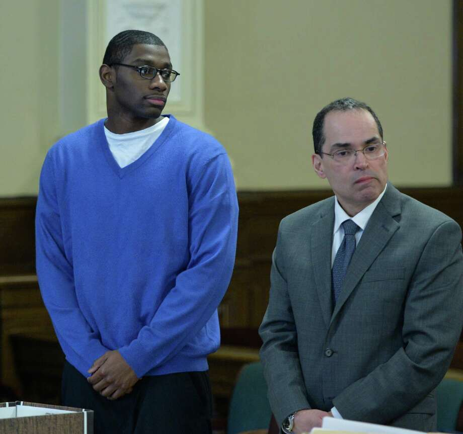 Defendant Ariel Myers, left stands with attorney Jay Hernandez as the judge returns to the courtroom during Myers' third trial in the 2009 shooting of Robert Guynup March 4, 2014 in Rensselaer County Court in Troy, N.Y.         (Skip Dickstein / Times Union) Photo: SKIP DICKSTEIN / 00025951A
