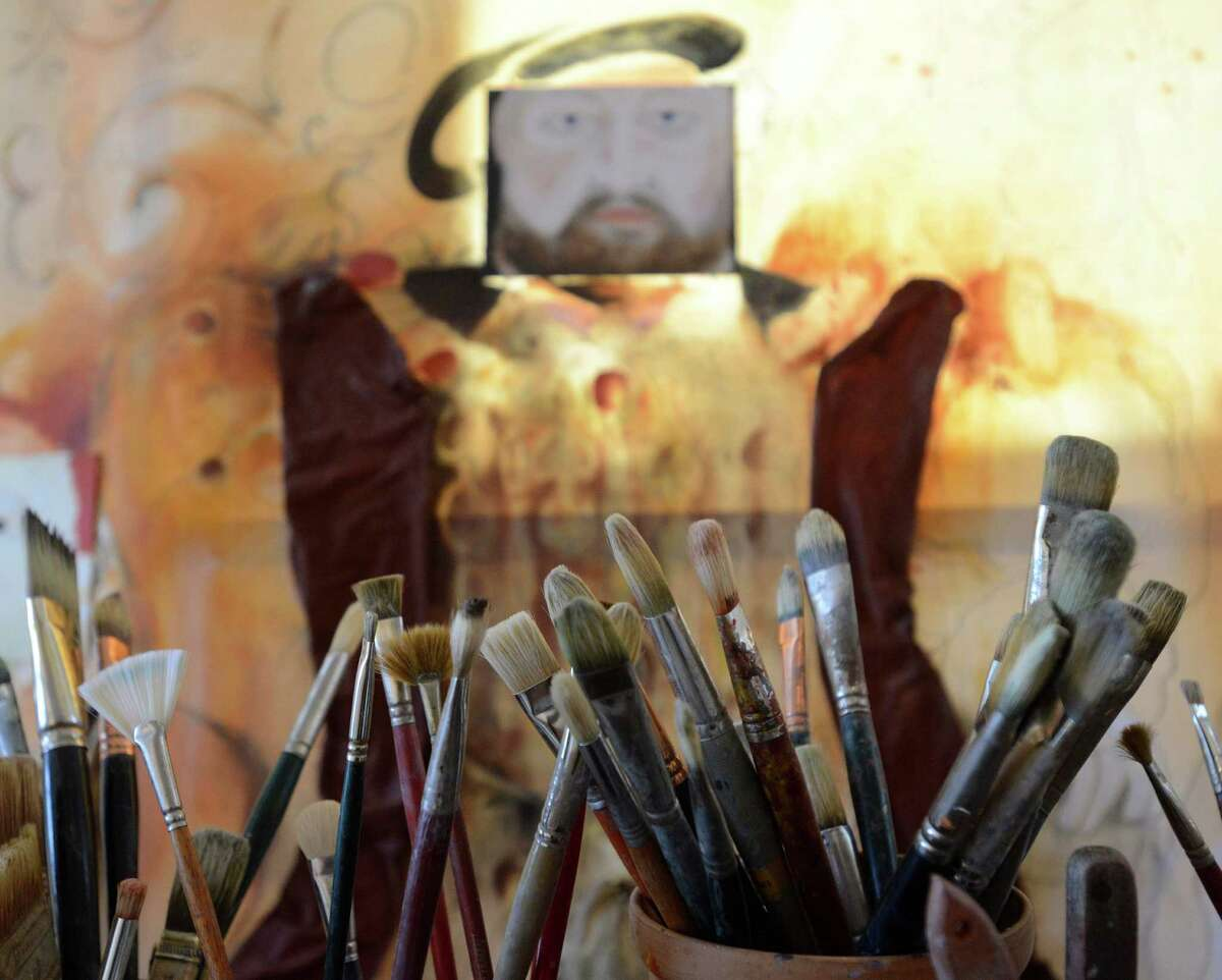 The brushes of artist Mira Hnatyshyn-Hudson are set in her studio. Friday, Feb. 21, 2014.