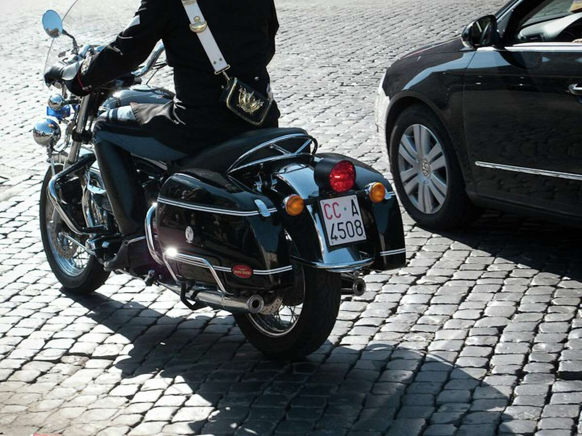 The Italians have the most beautiful cop bikes, of course, this one is a Carabinieri Moto Guzzi California seen at a funeral in Rome.
