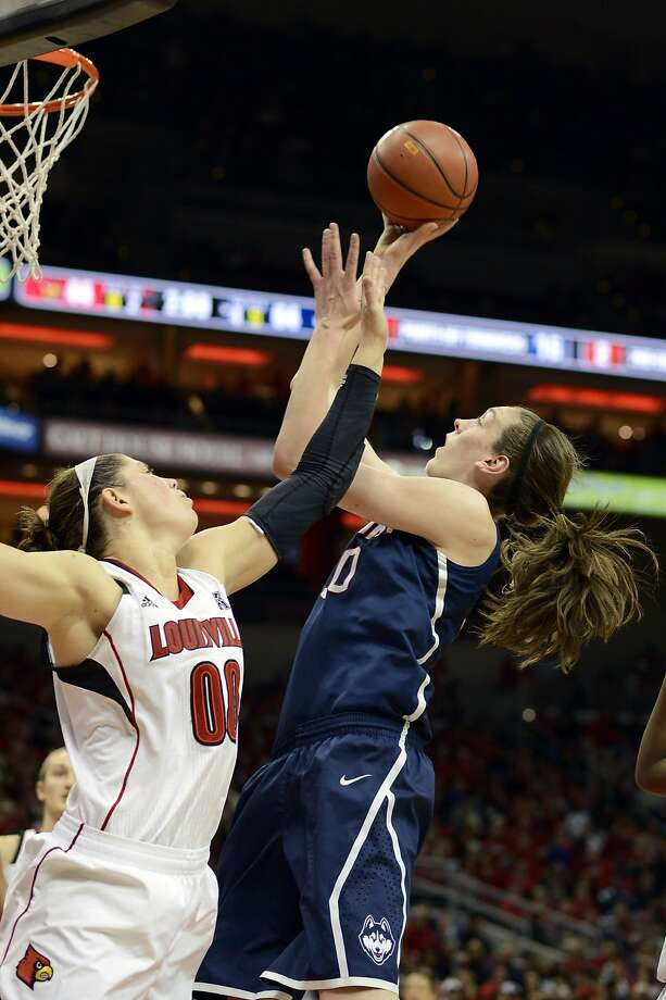 Mar 3, 2014; Louisville, KY, USA; Connecticut Huskies forward Breanna Stewart (30) shoots against Louisville Cardinals forward Sara Hammond (00) during the second half at KFC YUM! Center. Connecticut defeated Louisville 68-48.  Mandatory Credit: Jamie Rhodes-USA TODAY Sports Photo: Jamie Rhodes, Reuters