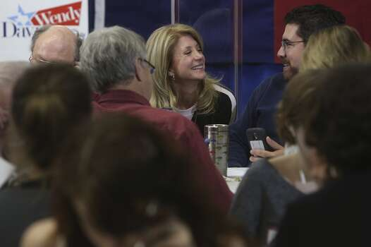 Senator Wendy Davis thanks volunteers including Patrick Doporto, right, at the phone bank at her campaign headquarters in Fort Worth on Tuesday, March 4, 2014. Photo: Lisa Krantz, San Antonio Express-News